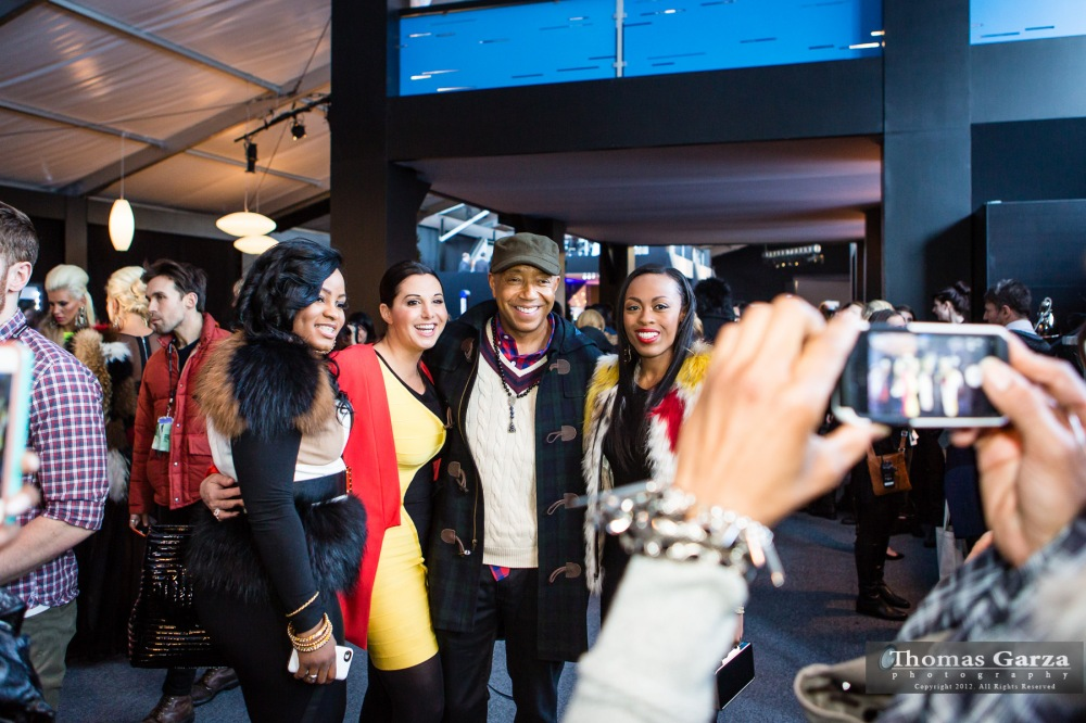 Russell Simmons at the Herve Leger Fall 2013 Fashion Week Show Posing with Fans