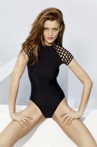 Model Cintia Dicker wearing Black Lattice Sleeve Maillot ( Photo Credit: Lenny Swimwear)